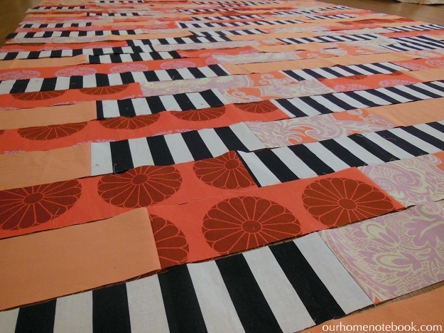 striped quilt laying out stripes