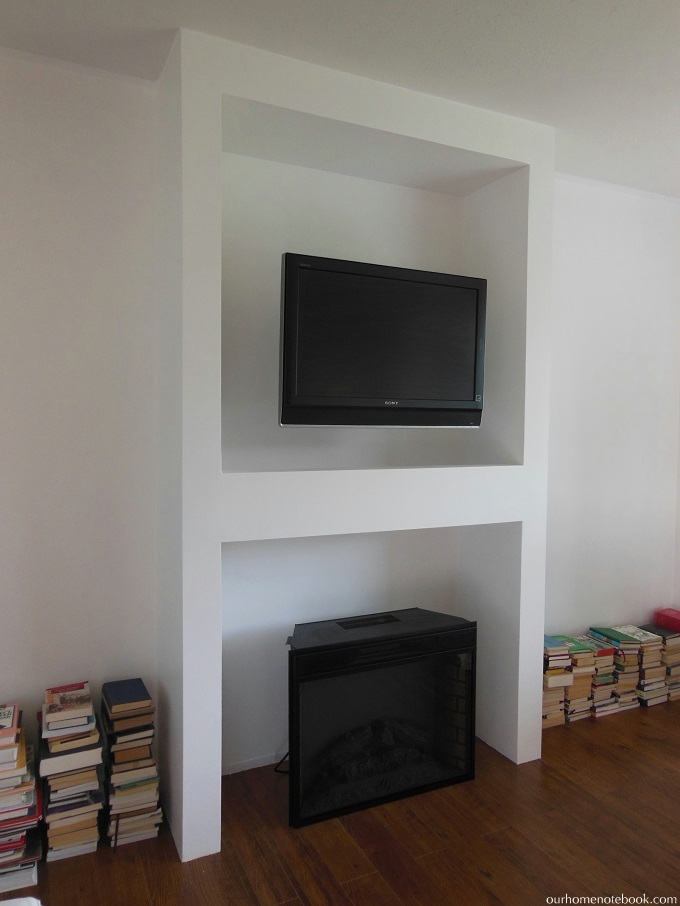 Remodelaholic | Built-In Fireplace Surround and Shelving with ...