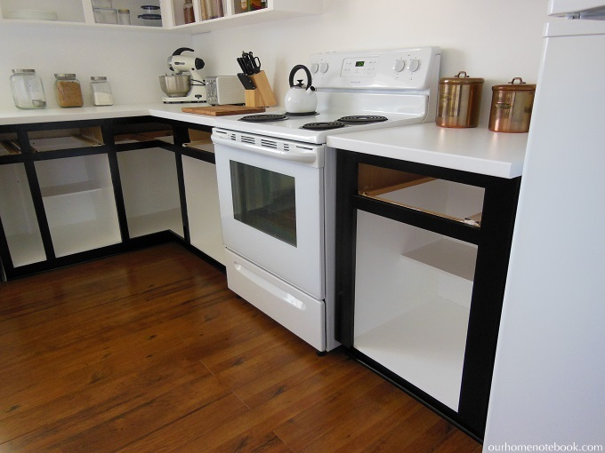 Budget kitchen renovation paint our home notebook for Black lower kitchen cabinets