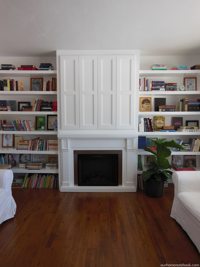 Remodelaholic Built In Fireplace Surround And Shelving With Hidden